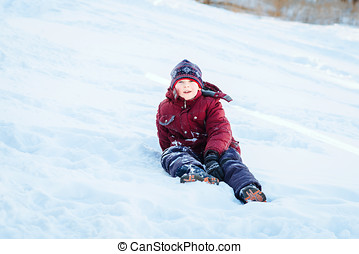 boy in snow - 9-year-old boy sitting on snow