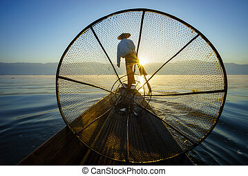 Fishermen in Inle Lake at sunrise, Shan State, Myanmar -...