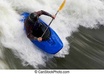 Whitewater Surfing Too - A slow shutterspeed shot of a...