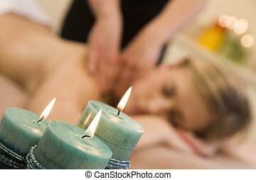 Candlelit Massage - Concept shot showing andles in focus in...