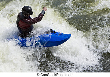 Whitewater Surfing - A fast shutterspeed shot of a kayaker...