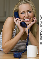Hanging On The Telephone - A beautiful young blond woman on...