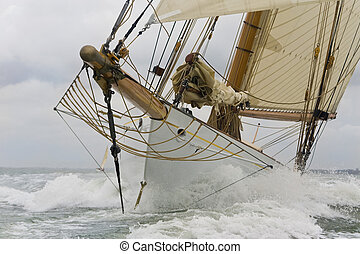Breaking The Waves - Close up on the bow of a classic...