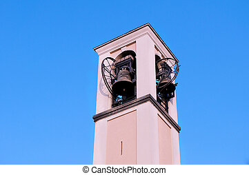 Bell tower on the sky background