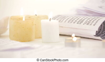 Note sheets and candles Close-up