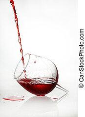 Broken glass with red liquid