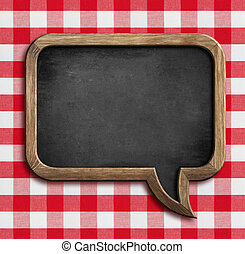 menu chalkboard speech bubble on table with picnic...