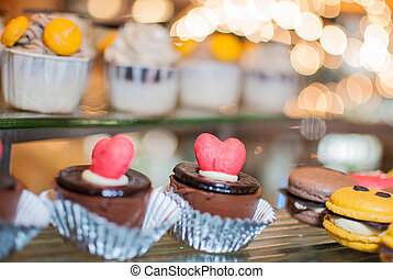 Wedding cupcake with love shaped decoration on top