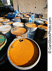 oil barrels - Rusty oil barrel container drums in junk yard