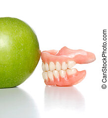 denture and apple
