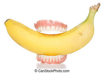 banana teeth - Smiling banana false teeth biting into health