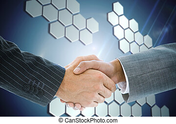 Composite image of business handshake against technological...