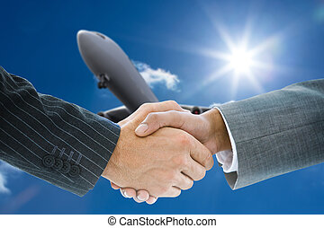 Composite image of business handshake against 3d plane...