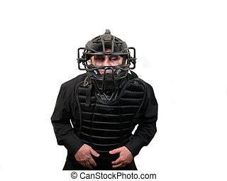 Baseball umpire - A baseball umpire wearing a mask, and...