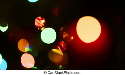 burning candle on background of holiday lights - changing focus