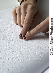 Blind reading text in braille langu - Blind woman reading...