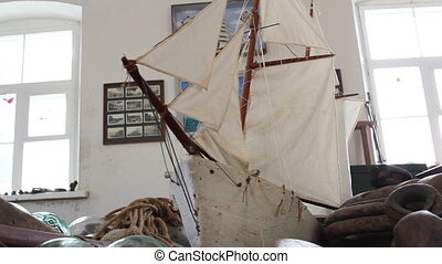 An old ship model with some rusty things on the side - An...