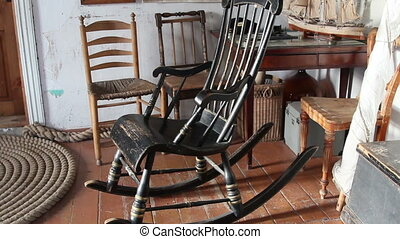 The black rocking chair - The black old rocking chair there...