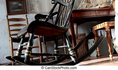 The rocking chair and other things on the room - A room...