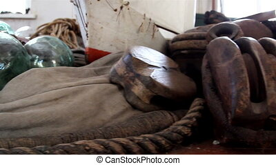An old rusty metal with a rope - An old rusty metal from a...