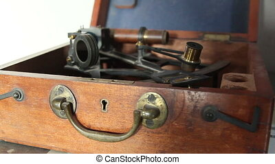 A sextant on a box - A sextant inside a box an instrument...