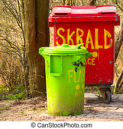 Urban environment - plastic rubbish bins in a recycling centre