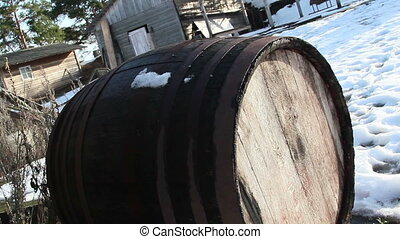 An old wooden barrel beside the boat - An old wooden barrel...