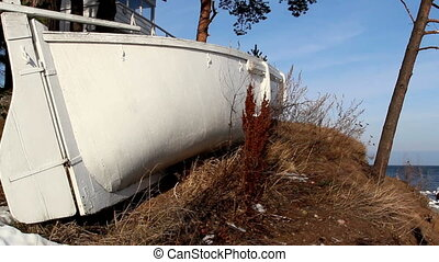 A white boat on standby - A white boat on stand by beside a...