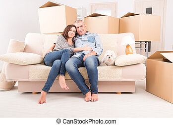 Couple at new home - Happy mature couple celebrating their...