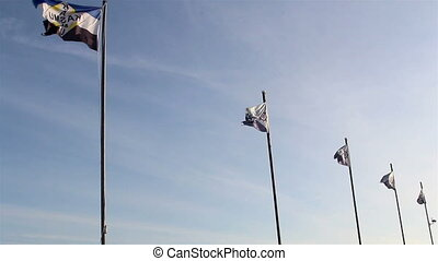 Five waving flags on the pole - Five flags on the pole...