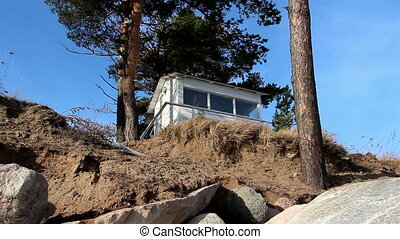 A white house on a cliff - A white house located near the...