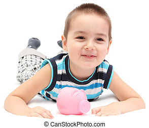happy child with piggy bank