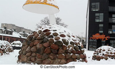 Some rocks formed into oblong shaped covered with snow -...