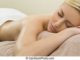 Simply Relaxed - A beautiful young blond woman relaxing in a...