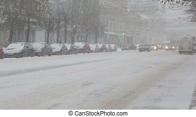 cars on a city street in a blizzard