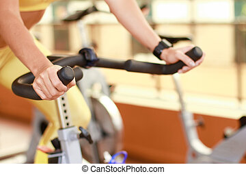 fitness - Woman on bike fitness