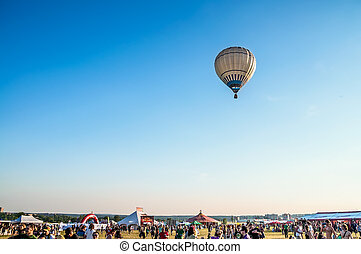 Air balloon above music festival - Air balloon flying over...