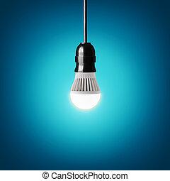 led bulb - Glowing led bulb on blue background