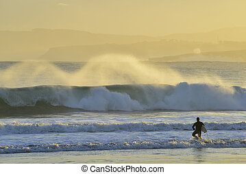 Surfer Silhouette slipping through the water in Santander...