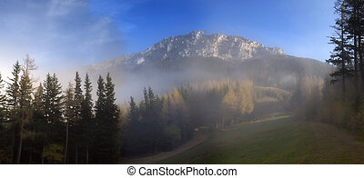 When The Fog Clears - A view of a Austrian mountain called...