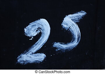 Number Twenty-five - White painted number twenty-five on...