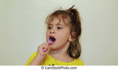 pretty little girl brushing her teeth
