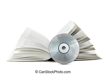 compact disk with book - open book with compact disk on...