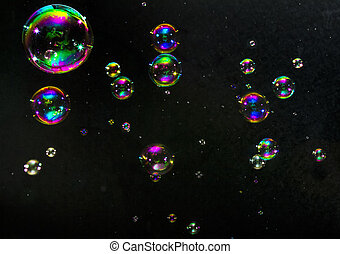 Multicolored bubbles on a dark background