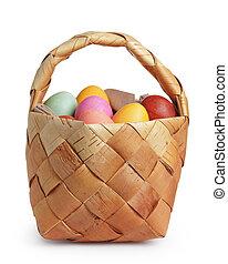 birch bark basket full of pastel colors easter eggs