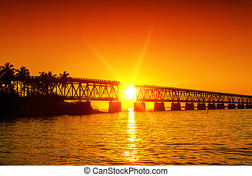 sunset at broken bridge - Colorful sunset with broken...