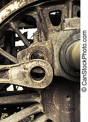 A wheel from an old style railway engine - steam locomotive.