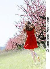 young girl in spring garden