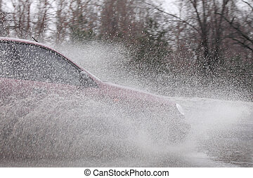 car at flood  - car moving by street at flood