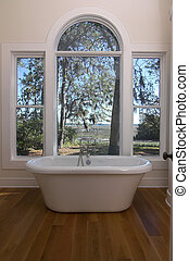 waterfront bathtub - bathtub with view out windows to...